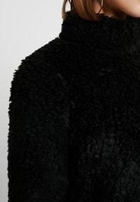 Vero Moda - VMVIRIGINIATEDDY HIGH NECK - Winter jacket - black - 5