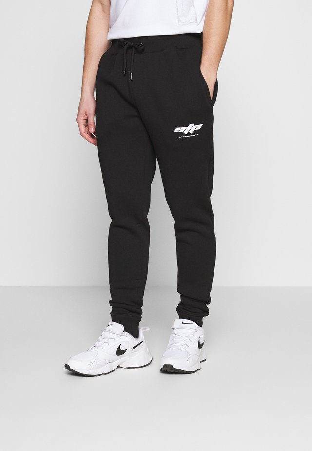 ELECTRO - Tracksuit bottoms - black