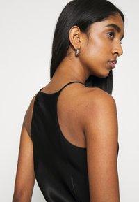Weekday - NOELLA STRAPPY DRESS - Vestido de cóctel - black - 3