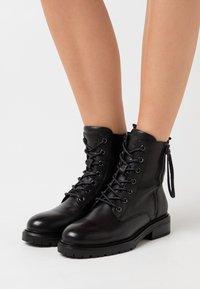 Carmela - LADIES BOOTS  - Lace-up ankle boots - black - 0