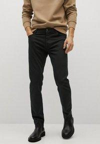 Mango - PATRICK - Slim fit jeans - black denim - 0