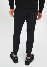 Calvin Klein Performance - Pantaloni sportivi - Black - 3