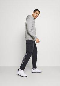 Nike Sportswear - PANT - Cargo trousers - black - 1