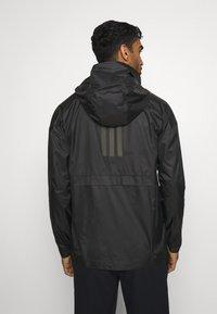 adidas Performance - OUTERIOR URBAN WIND.RDY - Hardshell jacket - black - 2