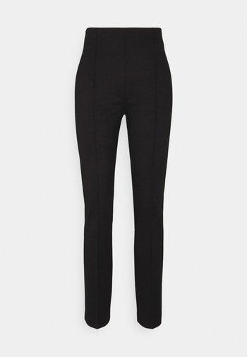 KALLAN PANTS - Trousers - black