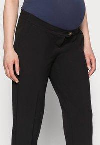 MAMALICIOUS - MLCERISE PANT - Spodnie materiałowe - black - 3