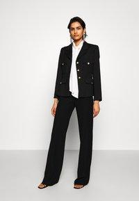 Emporio Armani - TROUSER - Trousers - black - 1