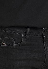 Diesel - THOMMER-X - Slim fit jeans - 069pw - 4