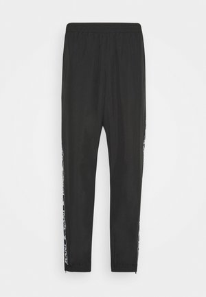 TAPE TRACKPANTS - Pantalon de survêtement - black