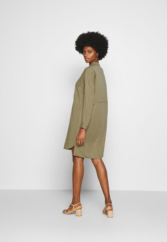 DRESS PATCH ON POCKETS - Shirt dress - bleached olive