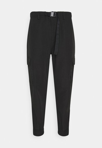TROUSERS CARROT FIT - Cargo trousers - black