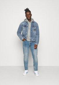 Calvin Klein Jeans - REGULAR JACKET - Spijkerjas - light blue - 1