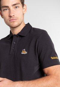Timberland - BOOT LOGO - Polo shirt - black - 3