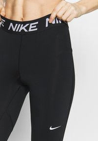Nike Performance - 3/4 sports trousers - black/white - 3