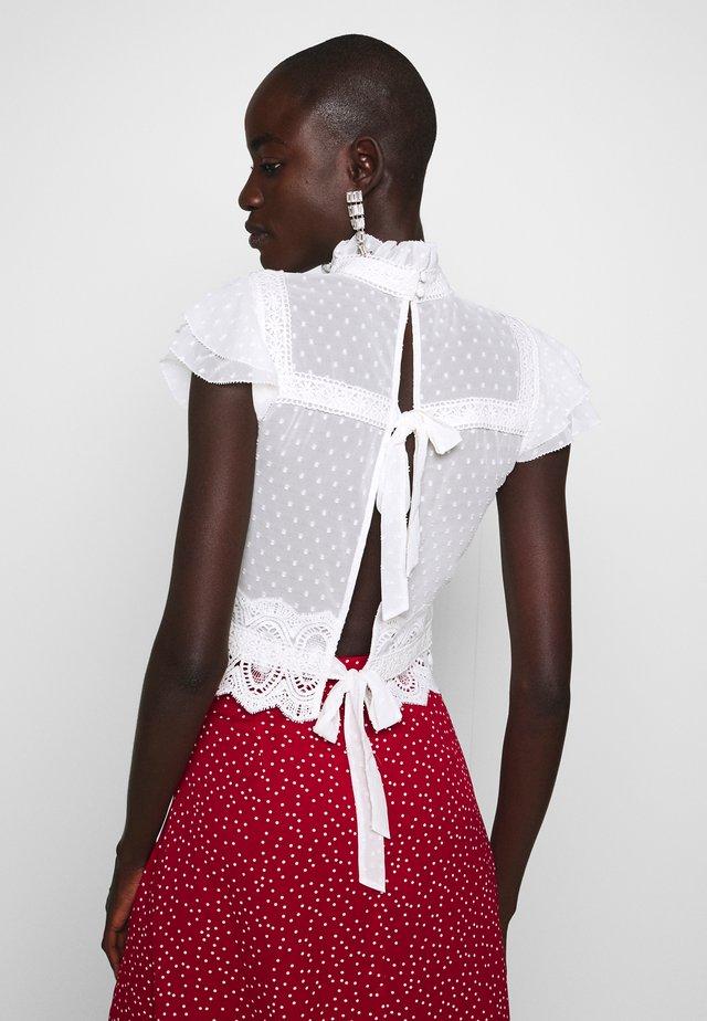 Blusa - white