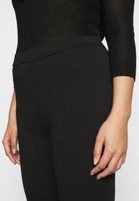 Vero Moda Curve - VMKAMMA FLARED PANT - Bukse - black - 4