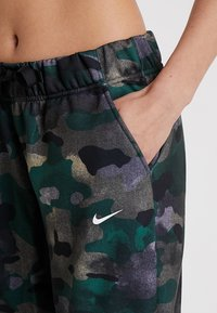 Nike Performance - REBEL ALL IN 7/8 - Tracksuit bottoms - club gold/white - 4