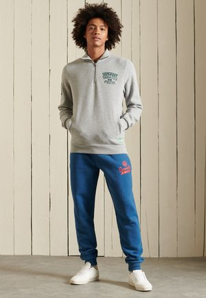COLLEGE - Tracksuit bottoms - rich blue marl