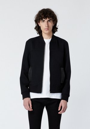 EN LAINE ZIPPÉ ET POCHES EN CUIR - Light jacket - black