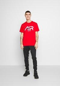 Nike Sportswear - Pantaloni sportivi - black/white - 1