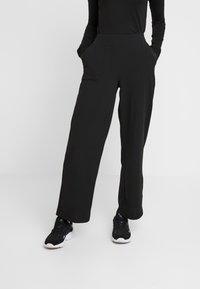 ONLY - ONLMARTA ROCKY WIDE PANTS - Pantaloni sportivi - black - 0