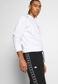 Kappa - GAWINJO - Pantalón corto de deporte - caviar - 3