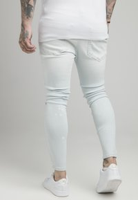 SIKSILK - BLEACH SPLAT RIPPED KNEE - Jeans Skinny Fit - ultra light wash - 2