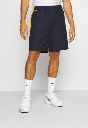 TENNIS SHORT BLOCK - Träningsshorts - navy blue/broom white