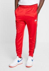 Nike Sportswear - Tracksuit bottoms - university red - 0