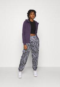 Nike Sportswear - Tracksuit bottoms - purple chalk - 1