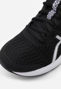 ASICS - PATRIOT 12 - Zapatillas de running neutras - black/white - 5