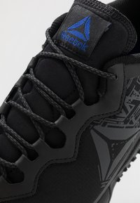 Reebok - ALL TERRAIN CRAZE - Trail running shoes - black/cold grey/cobalt - 5