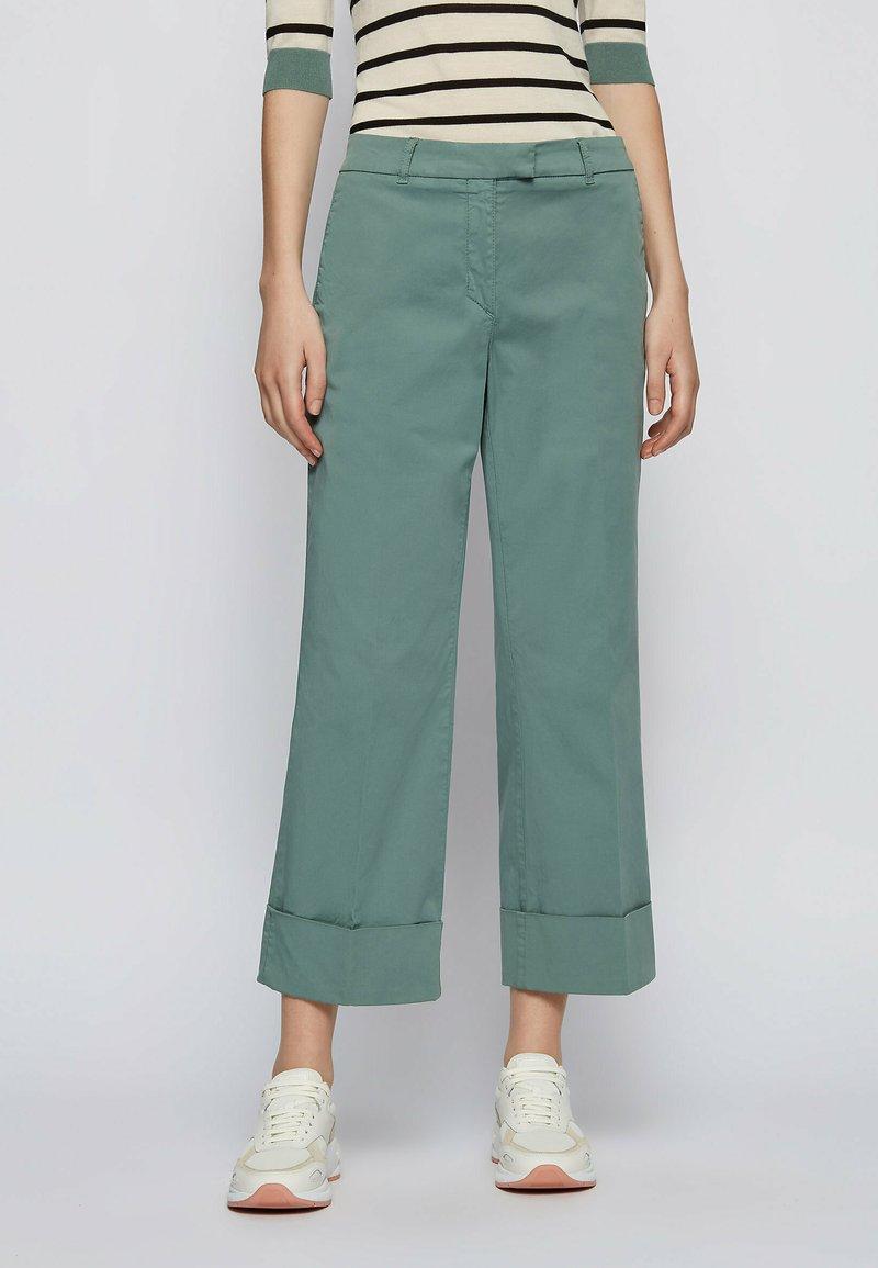 BOSS - TAROMA - Trousers - light green