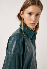 PULL&BEAR - Faux leather jacket - mottled dark green - 3