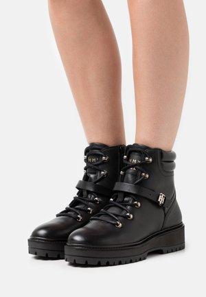 FLAT BOOT - Platform ankle boots - black