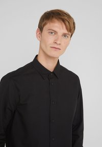 Versace Jeans Couture - CAMICIE  - Shirt - nero - 4