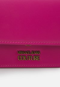 Versace Jeans Couture - CHARMS CROSSBODY - Across body bag - fuxia - 6