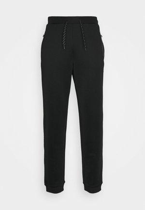 ROMFORD - Teplákové kalhoty - black