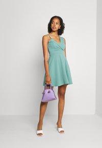 WAL G. - RIRI SKATER DRESS - Koktejlové šaty/ šaty na párty - sage green - 1