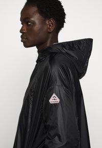PYRENEX - WATER REPELLENT AND WINDPROOF - Waterproof jacket - black - 7