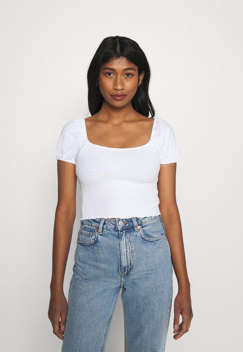 Hollister Co. - CAP SLEEVE SMOCK - Camiseta estampada - white