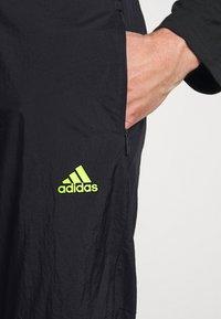 adidas Performance - ULTRA PANT - Trainingsbroek - black/yellow - 4