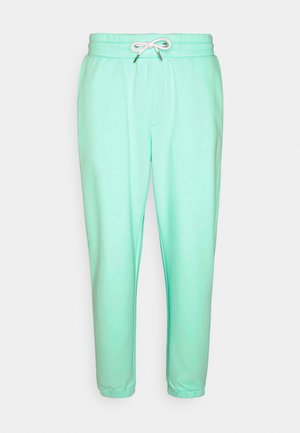 UNISEX - Tracksuit bottoms - light blue