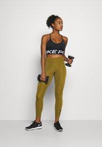 Nike Performance - 7/8 TROMPE  - Tights - olive flak/black - 1