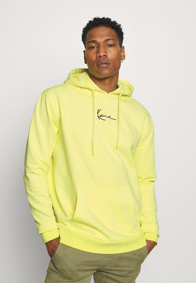 SIGNATURE WASHED HOODIE UNISEX - Sweatshirt - light yellow