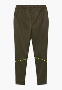 Nike Sportswear - TAPERED PANT - Tracksuit bottoms - cargo khaki/volt - 1
