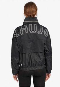 khujo - NABILA - Light jacket - black - 2