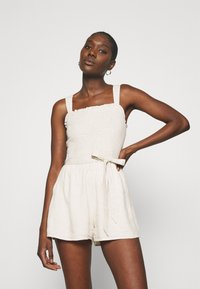 Abercrombie & Fitch - TIE STRAP SMOCKED ROMPER - Jumpsuit - flax - 0