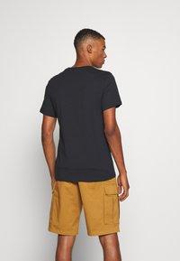 Levi's® - GRAPHIC CREWNECK TEE - T-shirt con stampa - black - 2