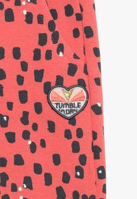 Tumble 'n dry - JASMIL BABY - Tracksuit bottoms - deep sea coral - 4